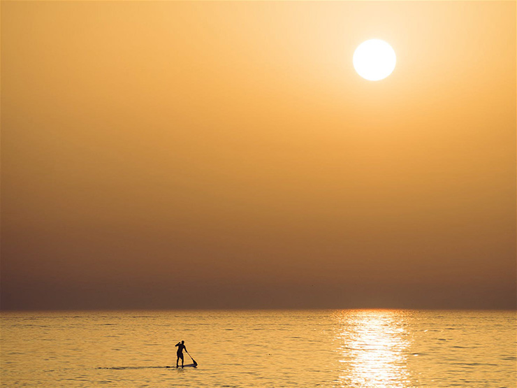 Beat the crowds with a a paddleboarding session first thing in the morning